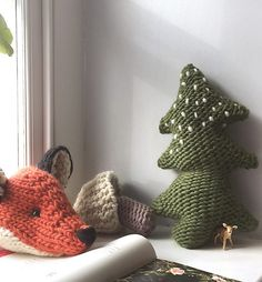 Free Knitting Pattern for Woodland Collection - This collection includes patterns for an evergreen tree shaped pillow, a wild mushroom, and a fox head. Designed by Claire Garland
