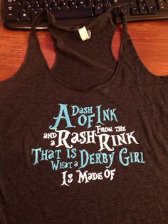 A Dash of Ink Racer back Grey Tank. Please notes that these Bella tanks run about a size to a size in a half small.
