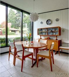 Mid Century Modern Dining Room with traditional accents- those look just like our dining room chairs! Mid Century Modern Dining Room, Mid Century Modern Decor, Mid Century Furniture, 60s Furniture, Furniture Design, Futuristic Furniture, Plywood Furniture, Mid-century Interior, Interior Ideas