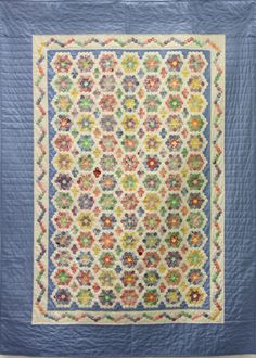 "<p>1st ~ Grame's Little Garden (120) ~ Tess Herlan ~ 61""x82"" </p><p>I love having an English paper-piecing project to take with me. A previous Grandmother's flower garden quilt I made used 3/4"" hexagons. This quilt, done in 30's reproduction fabrics, is made of 1/2"" hexagons. It was started at last year's show and was my ""carry project"" for the year. Hand-pieced. Hand-appliquéd. Hand-quilted. Source—Pattern: Traditional ""Grandmother's Flower Garden.""  </p>"