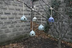 A collection of handmade ceramic bird houses by Katie Austin Ceramics.  www.katieaustinceramics.com