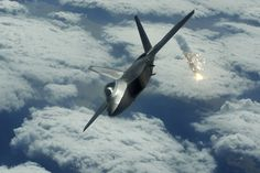 Lockheed Martin F-22 Raptor shooting out Flares during a training flight over Japan.