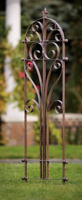 """Scrolling flat iron brings a touch of """"The Boot"""" to your garden with the Italian Iron Trellis. A stately finial and side spheres lend an air of handsome elegance and Old World beauty. Michaelangelo and Donatello would be proud!Charcoal brown powder-coated finish"""