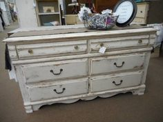 SOLD - Vintage 6 drawer dresser or media cabinet - painted crisp white distressed and finished in a clear wax. ***** In Booth D8 at Main Street Antique Mall 7260 E Main St (east of Power RD on MAIN STREET) Mesa Az 85207 **** Open 7 days a week 10:00AM-5:30PM **** Call for more information 480 924 1122 **** We Accept cash, debit, VISA, Mastercard, Discover or American Express