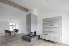 Penthouse V is a holiday home for a family of seven in Pörtschach, Austria. The Austria based studio destilat positioned the penthouse in the roof structure of a cinema. Interior Design Examples, Interior Design Inspiration, Modern Interior, Interior Architecture, Contemporary Architecture, Design Studio, House Design, Paint Fireplace, Concrete Fireplace