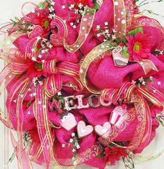 XL Deco Mesh Valentine's Day Wreath Filled With Ribbons, Dainty Flowers, Welcome Sign. $179.97, via Etsy.
