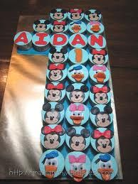 1st birthday boy cup cakes - Google Search Use any topping but make the letters in the middle.  Cute idea.