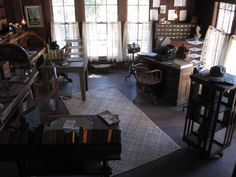 """""""Call of the Wild"""" -- Click through to see details of Jack London's cottage (his ranch is now a state park and museum in Glen Ellen, California). I love everything about this room, but especially the revolving bookcase and the card catalog in the corner. Several other views here: https://www.flickr.com/photos/26380045@N03/4280246075/in/photostream/"""