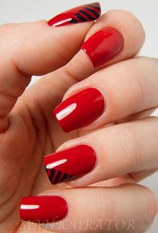 Red nails with a hint of black—perfect for those fall date nights!