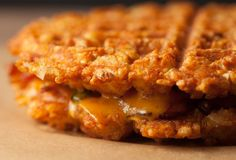 A bacon-jalapeño grilled cheese, made of waffles that're made of tater tots