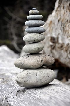 Beautiful stacked beach stones. I have an itch to skip 3 of them ..