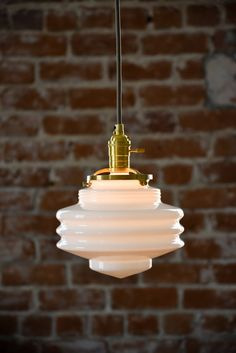 Wire can be adjusted with set screw at canopy and any length wire can be accommodated.  Stunning handblown opal glass pendant light with solid