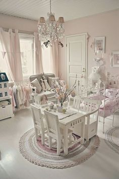 Shabby chic pink and white little girl's room. Love the antique iron bed painted white, dollhouse, tiny table and chairs-everything!