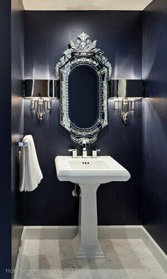 Dark Blue/Purple walls, Etched Mirror w/Beautiful detailing & Silver Wall Sconces #bathtomb #chic