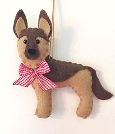 This sweet ornament makes a great gift for anyone who loves or has a German Shepherd! He is designed and handmade by me. He is made of soft felt and has a red gingham bow. He is about 5 inches long. Find more cute felt critters here