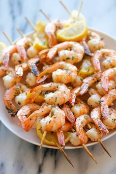 Garlic Shrimp Kabobs - The easiest, most flavorful way to prepare shrimp - so perfect for summer grilling or roasting!Lemon Garlic Shrimp Kabobs - The easiest, most flavorful way to prepare shrimp - so perfect for summer grilling or roasting! Best Seafood Recipes, Shrimp Recipes Easy, Skewer Recipes, Prawn Recipes, Grilling Recipes, Cooking Recipes, Healthy Recipes, Healthy Grilling, Simple Recipes