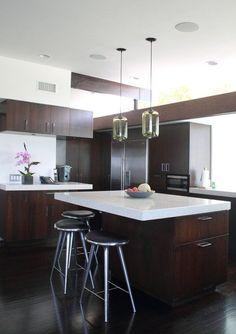 Love this  modern kitchen with dark cabinetry