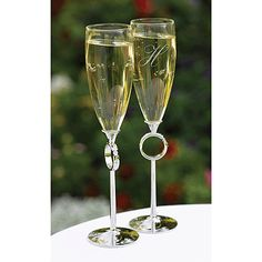 """With This Ring Flutes Nickel-plated stems with rhinestone-studded rings. 10 1/4"""". May be personalized with names and event date, or single initial (if names and date are not wanted) in the engraving style of your choice. Sold in a set of two."""