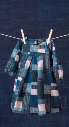 """Boro Sateen Dress: The design on this dress is inspired by """"boro,"""" the traditional Japanese technique of patchwork and textile mending. In order to preserve clothing and linens, people carefully stitched patches and scraps of different fabrics to mend holes and tears. The patterns and pieces of patches often took on beautiful, artful arrangements, even though they are completely unplanned and created out of necessity."""