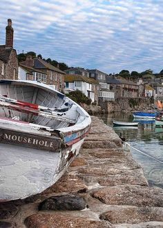 MOUSEHOLE, CORNWALL is a maze of narrow, winding streets filled with small shops, galleries and restaurants. English Village, Devon And Cornwall, Seaside Towns, Seaside Uk, England And Scotland, Le Far West, English Countryside, British Isles, Great Britain
