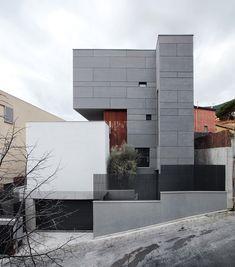 cement, stone, stone, orange.  black #garage door