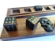 Dice made of bog oak with the age of about 3,500 years. The box is made of American Walnut with a skull made of bog oak 3500 years. Dice made in one copy and are of a kind exclusive. This is the gift dice, and are an unusual gift for your friends and relatives. | eBay!