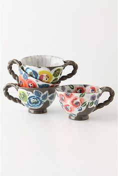 """Garden Plait Mug. Ranunculus blooms, simple pansies and grand roses grow upon the sedately hued stoneware of these braid-handled mugs.  Stoneware.  Dishwasher and microwave safe.  10 oz.  2.75""""H, 4.25"""" diameter.   #20838033  $14.00  http://www.anthropologie.com/anthro/catalog/productdetail.jsp?id=20838033&catId=HOME-TABLETOP-DINNERWARE&pushId=HOME-TABLETOP-DINNERWARE&popId=HOME&navAction=top&navCount=408&color=040&isProduct=true&fromCategoryPage=true&subCategoryId=HOME-KITCHEN-MUGS"""