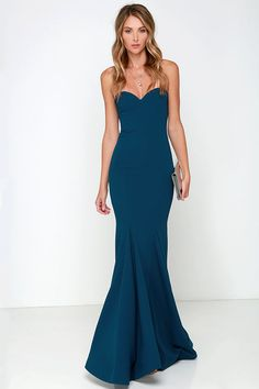 """Amp up your """"curve"""" appeal at that upcoming gala with the Sorella Navy Blue Strapless Maxi Dress! A strapless sweetheart bodice has a stunning fitted shape thanks to a hidden V-bar at front, boning and elastic at back, and princess seams. The woven material makes its way down into the maxi skirt finished with flaring godets, and hidden bottom band for added structure. Hidden back zipper with clasp."""