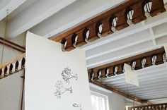 """""""London-based artist Tracey Emin hangs her drawings from wooden slats attached to the ceiling"""" Genius!"""