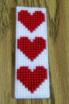 Valentine Bookmark, Plastic Canvas Bookmark, Handmade, Plastic Canvas A great way to mark where you left off reading your book. This bookmark is made with plastic canvas, acrylic yarn using a simple stitch. It measures approximately 5 x Plastic Canvas Books, Plastic Canvas Stitches, Plastic Canvas Coasters, Plastic Canvas Ornaments, Plastic Canvas Tissue Boxes, Plastic Canvas Christmas, Plastic Canvas Crafts, Plastic Canvas Patterns, Cross Stitch Stocking
