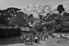 Sebastião Salgado chronicles and celebrates coffee growers Transporting coffee on mules in a village surrounded by coffee trees. Region of Yirga Cheffe, Ethiopia 2004. ©SEBASTIAO SALGADO/AMAZONAS IMAGES FOR ILLY