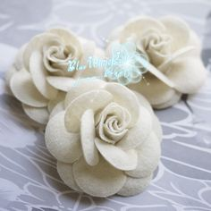 5pcs  Nonwoven fabric flower  Camellia Flowers Accessories Process pin Monochrome wool  Ivory White Shell From Ouyang. $4.49, via Etsy.