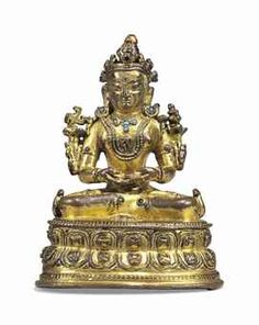 A RARE GILT-BRONZE FIGURE OF A BON DEITY TIBET, LATE 15TH CENTURY Seated in vajrasana on a lotus base with both hands in dhyanamudra, his chest cast with the aum character, his face with a serene expression, jewellery inset with turquoise, resealed 3 ½ in. (8.6 cm.) high