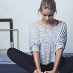 Flow through your yoga poses in draped pullover sweater.