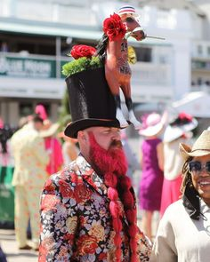 A look at an iconic outfit from Kentucky Derby 147 - a top hat with a horse wearing a hat. Kentucky Derby Hats, Hat For Man, Wearing A Hat, Captain Hat, Horses, Photo And Video, Men, Outfit, Outfits