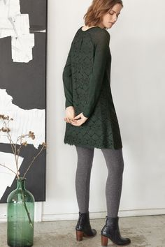 Willow Sweater Dress - A fabulous little dress in berry black or sophisticated pine. Straight cut, the front panel and raglan sleeves are in pure merino wool but the hemline and the back panel are in a floral lace. Fully lined. 100% Merino. Back 100% Polyester Front 100% Merino, Lining 100% Polyester
