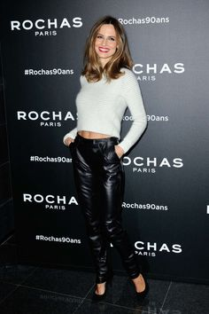 Ariadne Artiles on red carpet in white cropped sweater and black leather pants