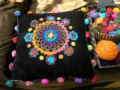 Crochet Flowers and Pom Poms Cushion Inspiration