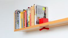 Wall-Mounted Shelf Prevents Toppling Books With Sliding Lock // Hold on Tight by Brooklyn design studio Colleen and Eric Wall Bookshelves, Wall Mounted Shelves, Storage Shelves, Narrow Bookshelf, Bookcases, Shelving, Cute Home Decor, Shelf Design, Beautiful Wall