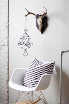 White Eames Chairs + White Walls= Scandavian  Perfection.  Shop this style and more at www.smartfurniture.com