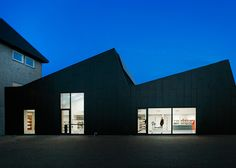 A sawtooth roofline gives this library and cultural centre in Allerød an industrial feel that references its location on the site of an old factory