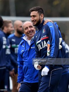 Head coach Italy Giampiero Ventura (L) and Gianluigi Donnarumma chat during the training session at the club's training ground at Milanello on November 14, 2016 in Florence, Italy.