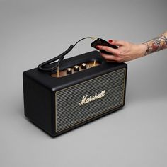A compact speaker with a powerful sound, the Stanmore Marshall Speaker has a great classic vintage look but is made for the modern age. Compatible with smartphones, a record player, even Apple TV. 3.5MM auxiliary input, or connect wirelessly through bluetooth technology. Please allow 10 days for shipping.