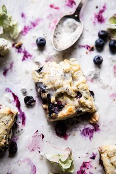 Blueberry Lemon Poppy Seed Scones - extra buttery, flakey, LOADED with blueberries & drizzled with the sweetest lemon poppy seed glaze @halfbakedharvest.com