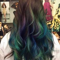How beautiful is this custom; oil slick inspired color by our colorist @kellieessensualslondon which was cut and styled by stylist @nildaessensualslondonnj