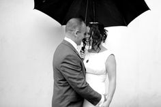 Raining Wedding Photo / Umbrella / Bride and Groom / Black and White / Wedding Portraits / Fun Wedding Photos / Rainy Wedding (Elly Brown Photography)