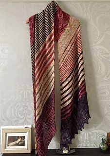 This wrap is HUGE! I don't think I blocked it hard but it's enormous! and I love it - Fantastic drape too - a really fab knit - this pattern is excellent! C1 is Blood on the Tarmac C2 is Coeur Lo...