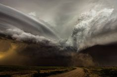 """""""Camelia Czuchnicki: Clash of the Storms This is a clash between two storm cells in New Mexico, each with its own rotating updraft. It appeared as though one updraft was anti-cyclonic, resulting in a very turbulent scene. It was a fantastic sight to..."""