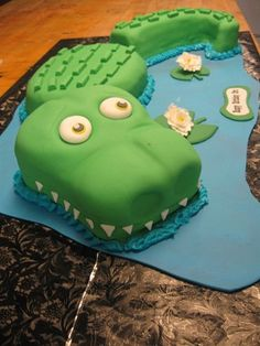 Crocodile cake for Peter Pan party. Maybe adds a clock
