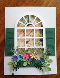 This uses Susan's Garden Conservatory Window with Poppystamps Small Madison Wikndow Shutter--also the window box. I printed off an ephemera cottage on textured Strathmore paper for the inside & cut it with Spellbinders Marvelous Squares.
